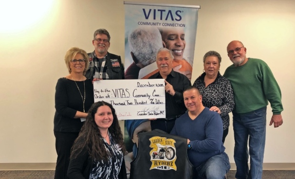 The group presents the ceremonial check to VITAS Community Connection